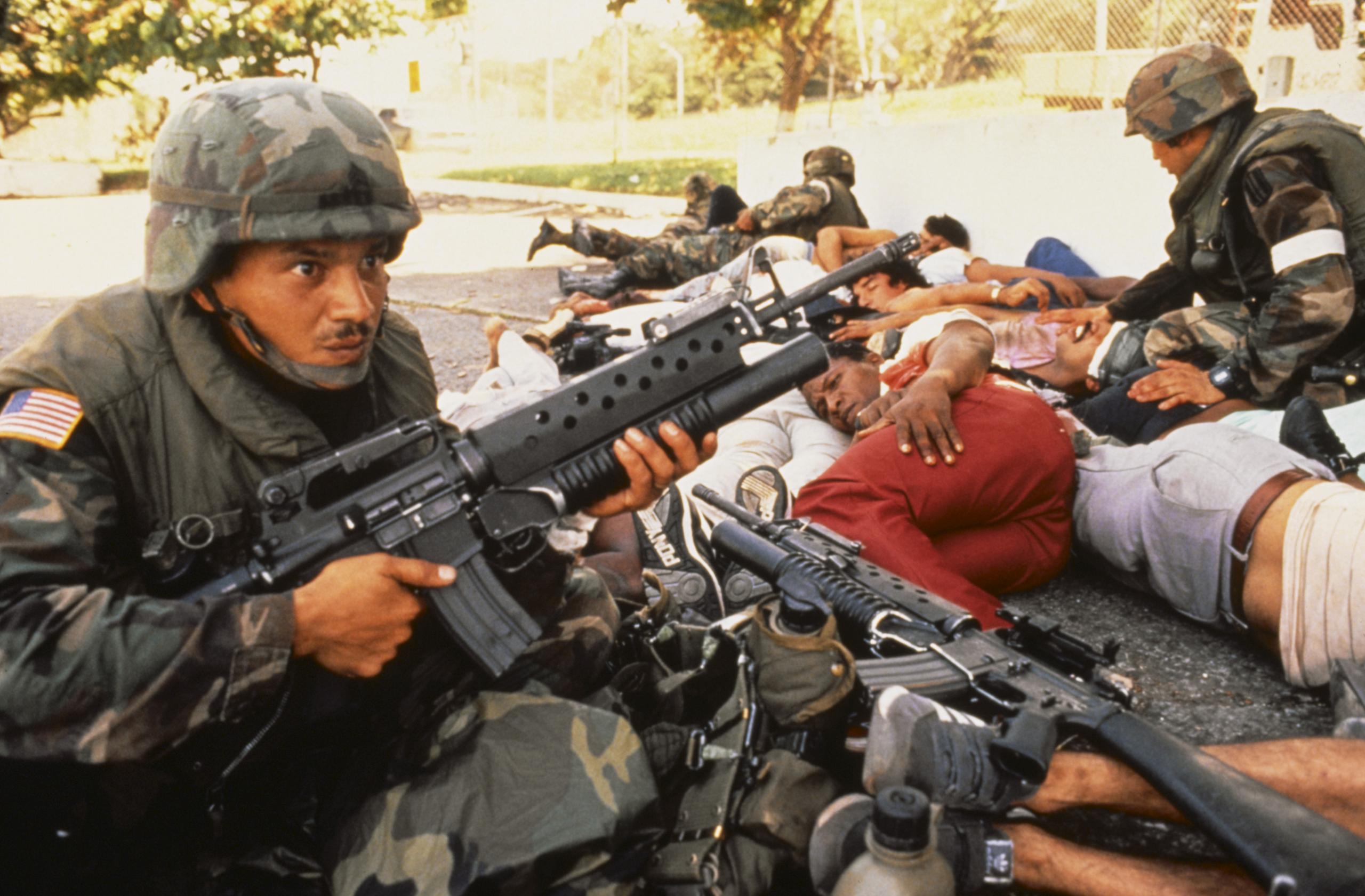 us troops taking cover with civvies in grenada.jpg