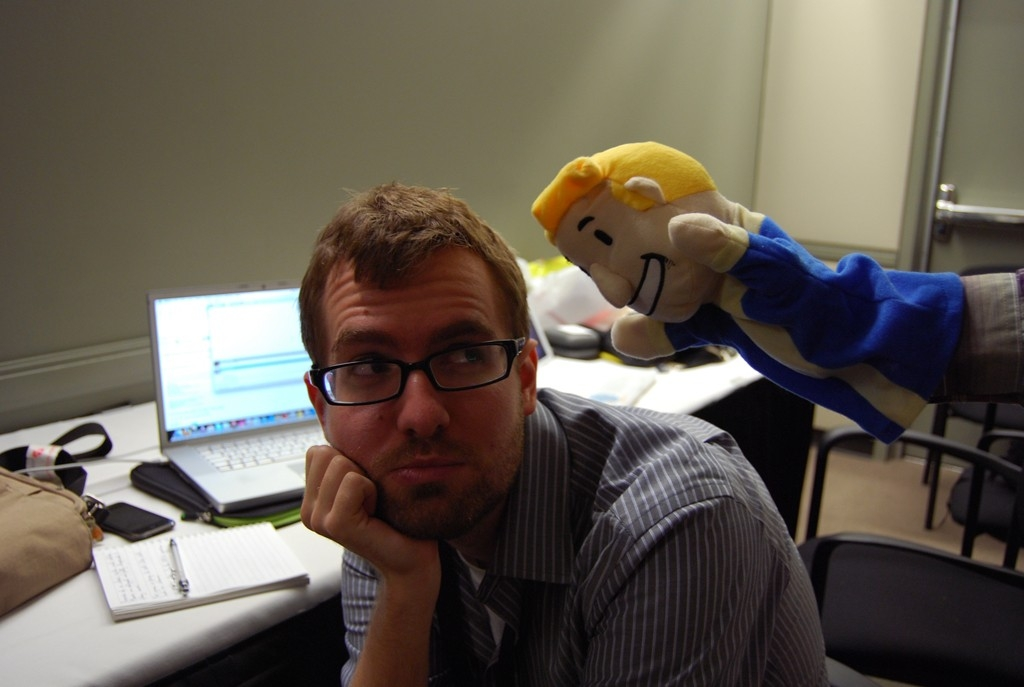 PAX Vault Boy puppet chearing up a weary gaming journalist